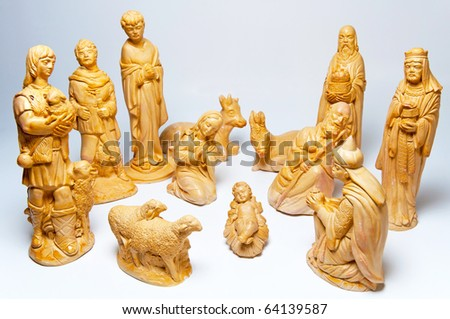 Picture of Christmas creche made of wooden figures. - stock photo