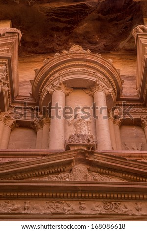 Picture of close up details on top part of Treasury house,  located in City of Petra, Jordan - stock photo