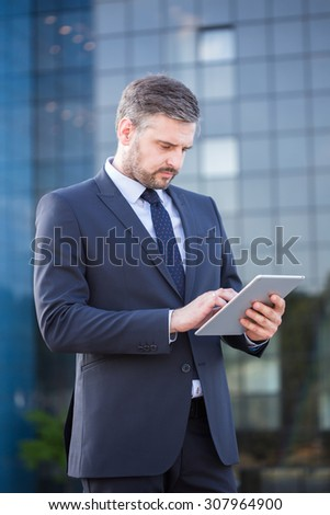 Picture of confident financial sector worker using laptop - stock photo