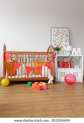 Picture of contemporary wooden furniture in babygirl room - stock photo