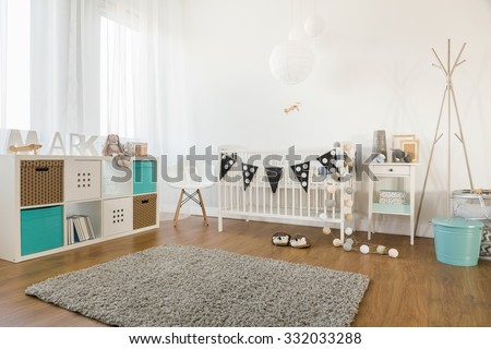 Picture of cosy and light baby room interior - stock photo
