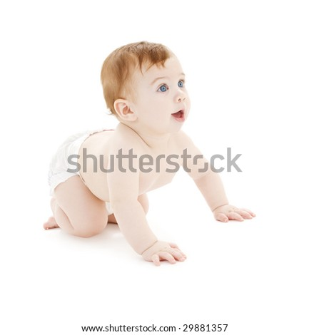 picture of crawling baby boy in diaper over white