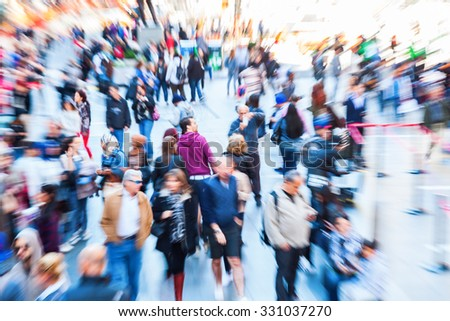 picture of crowds of people in the city with intentional zoom effect made by camera - stock photo