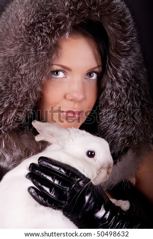 Picture of cute girl with white rabbit in her hands - stock photo