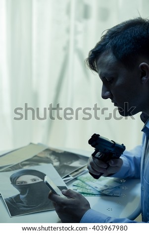 Picture of dangerous mysterious man with gun - stock photo