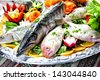 Picture of different sea fish plate arranged with vegetables. - stock photo