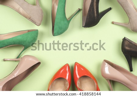 picture of different shoes, Shot of several types of shoes, Several designs of  women shoes. Leather Shoe. Pile of various female shoes on  light  background. Copy space for text. - stock photo