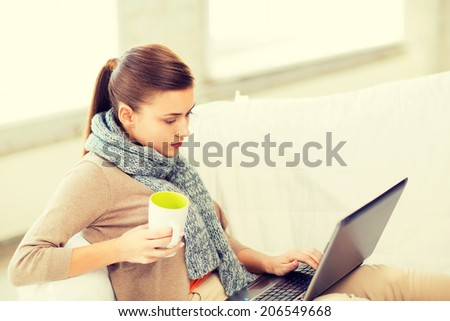 picture of diseased woman in scarf using laptop at home - stock photo