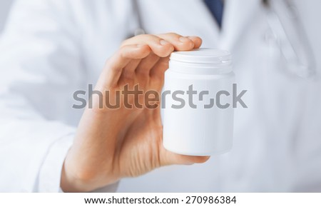 picture of doctor hands holding white pack - stock photo