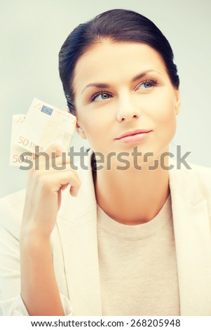 picture of dreaming businesswoman with cash money - stock photo