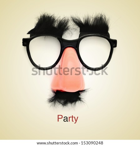 picture of fake glasses, nose and mustache and the word party on a beige background, with a retro effect - stock photo