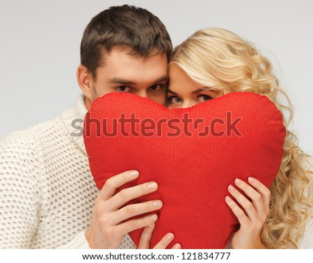picture of family couple in a sweaters with heart