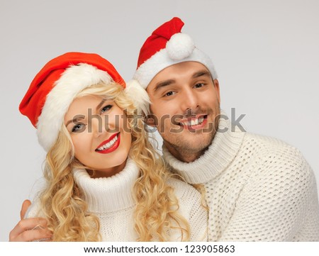 picture of family couple in sweaters and santa's hats