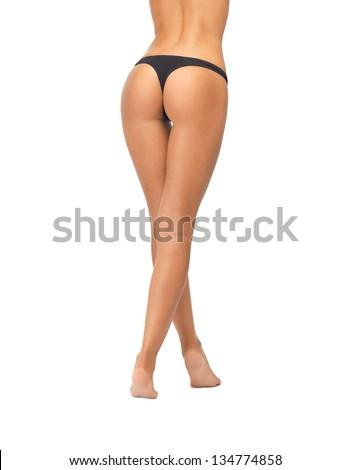 picture of female butt in black bikini panties - stock photo