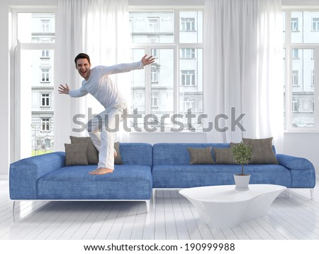 Picture of freaky man dancing on a blue couch - stock photo