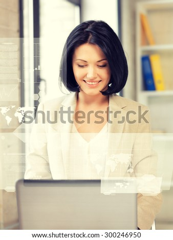 picture of friendly businesswoman with laptop computer and virtual screen