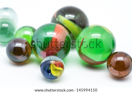 picture of glass marbles on white background - stock photo