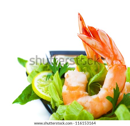 Picture of green salad with shrimps, Asian cuisine, fresh seafood platter, border isolated on white background, healthy eating concept, boiled prawn with vegetables, expensive delicates - stock photo