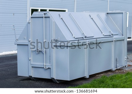 picture of grey closed skip for waste - stock photo