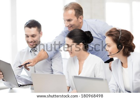 picture of group of people working in call center or office