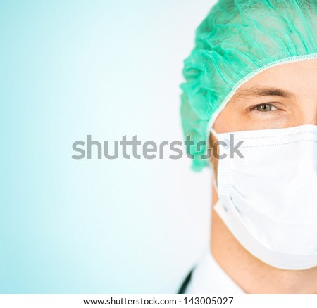 picture of half face of surgeon in medical cap and mask