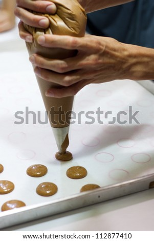 Picture of Hand Squeeze Soft Dough on Paper - stock photo