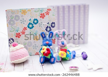 Picture of handmade knitted bunny rabbits and gift boxes - stock photo