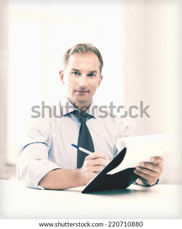 picture of handsome businessman taking employment inteview - stock photo