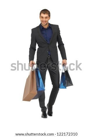 picture of handsome man in suit with shopping bags. - stock photo