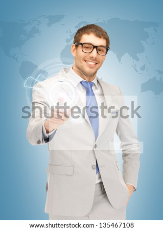 picture of handsome man pressing virtual button - stock photo