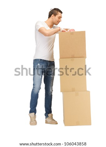 picture of handsome man with big boxes.