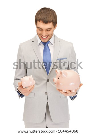 picture of handsome man with piggy bank - stock photo