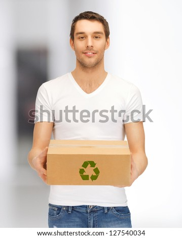 picture of handsome man with recyclable box - stock photo