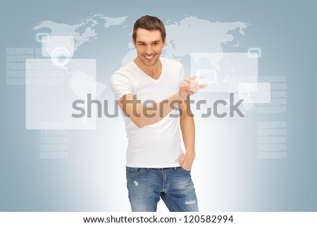 picture of handsome man working with touch screen