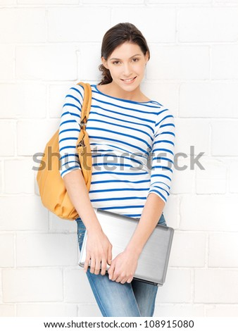 picture of happy and smiling teenage girl with laptop - stock photo