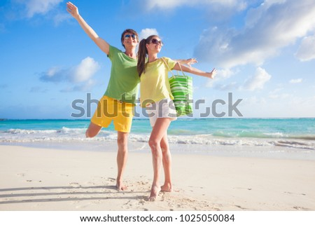 picture of happy couple in sunglasses having fun at the beach