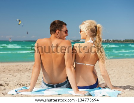 picture of happy couple in sunglasses on the beach - stock photo