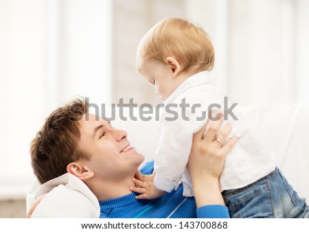 picture of happy father with adorable baby
