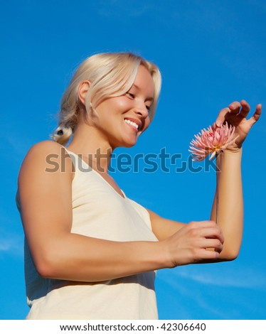 Picture of happy girl holding a flower