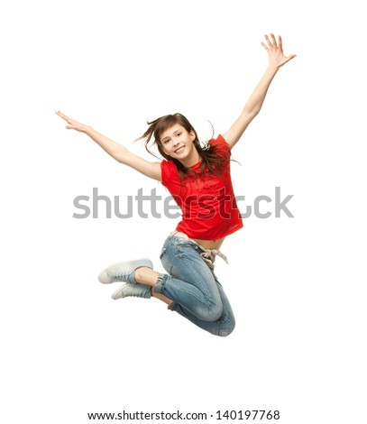 picture of happy girl jumping in the air - stock photo