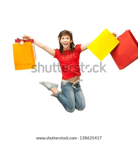 picture of happy girl with shopping bags .