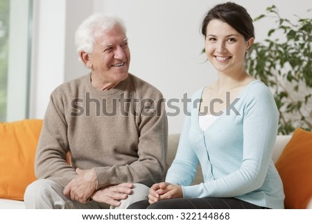 Picture of happy granddad with his smiling young granddaughter - stock photo