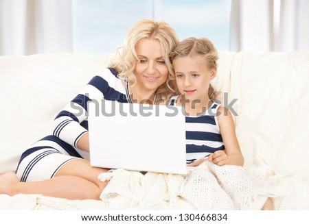 picture of happy mother and child with laptop computer - stock photo