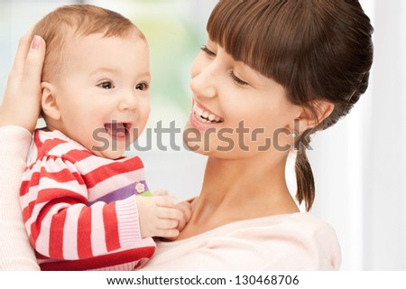 picture of happy mother with adorable baby at home