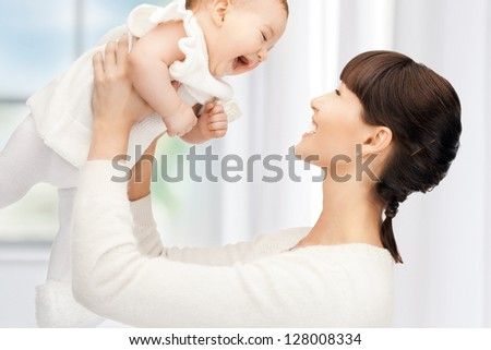 picture of happy mother with adorable baby (focus on woman) - stock photo