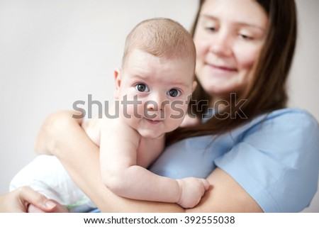 picture of happy mother with baby in hands