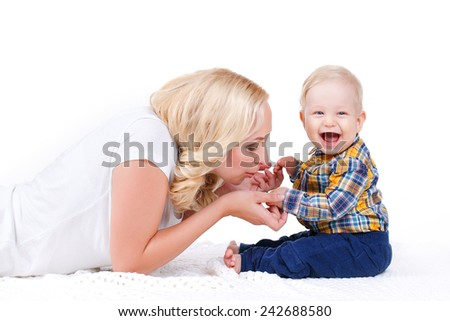 picture of happy mother with baby over white. Mother holding sweet baby boy. mother kissing her baby - stock photo