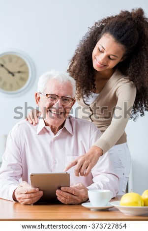 Picture of happy old man having family support - stock photo