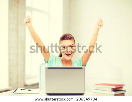 picture of happy student girl with laptop at school