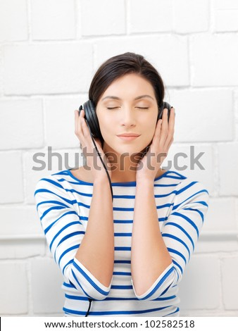 picture of happy teenage girl in big headphones - stock photo